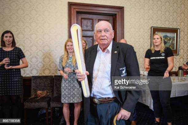 Former New Zealand sport shooter Jack Scott holds the Commonwealth Games Queen's baton during a Commonwealth Games Queens Baton Relay function at...