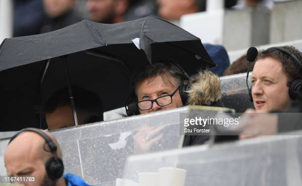 Former Newcastle player and now BBC radio 5 Live analyst Chris Waddle looks on from the wet press box during the Premier League match between...