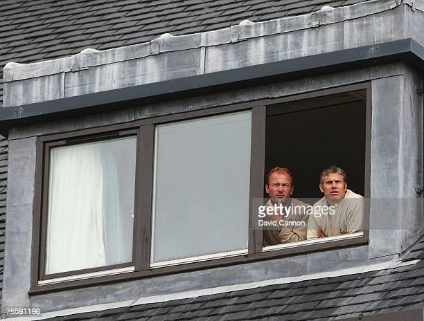 Former Newcastle United and England footballers Alan Shearer and Robert Lee watch from a balcony during the final round of The 136th Open...