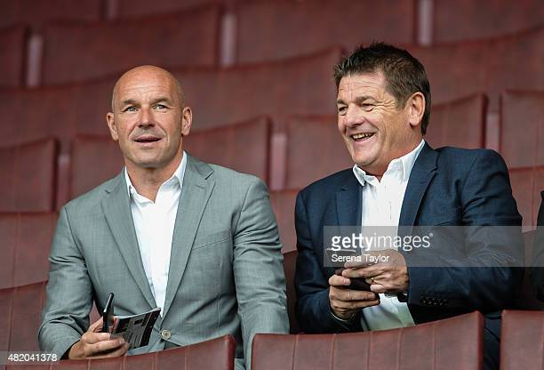 Former Newcastle United Head Coach John Carver and assistant coach Steve Stone sit in the stands during the Pre Season Friendly between Sheffield...