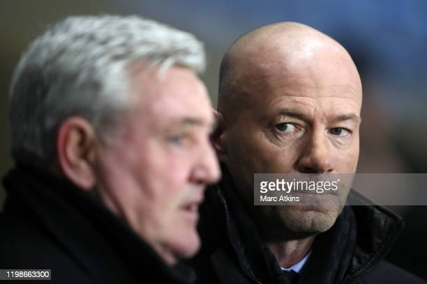 Former Newcastle United striker Alan Shearer alongside Steve Bruce manager of Newcastle United during the FA Cup Fourth Round Replay match between...