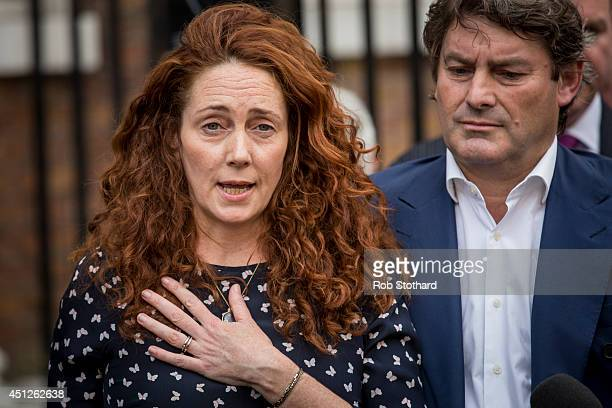 Former News International chief executive Rebekah Brooks and her husband Charlie Brooks give a statement outside their home on June 26, 2014 in...