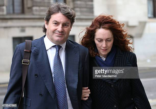Former News International chief executive Rebekah Brooks and her husband Charlie Brooks leave the Old Bailey on February 28 2014 in London England...
