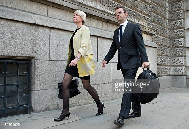 Former News of the World editor and Downing Street communications chief Andy Coulson and his wife Eloise leave the phonehacking trial at the Old...