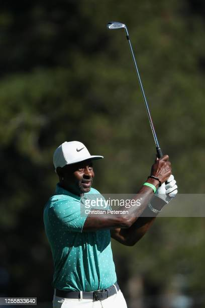 Former NFL athlete Jerry Rice primarily with the San Francisco 49ers plays his second shot on the first hole during the final round of the American...