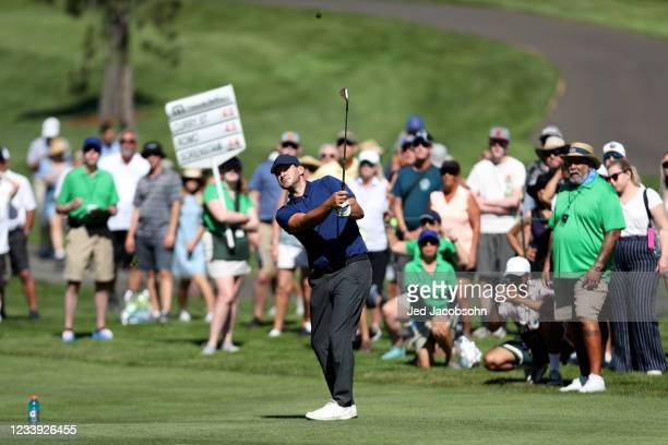 Former NFL athlete Tony Romo hits a shot from the second hole during the final round of the American Century Championship at Edgewood Tahoe South...