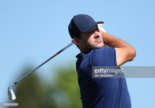 Former NFL athlete Tony Romo tees off from the first hole during the final round of the American Century Championship at Edgewood Tahoe South golf...