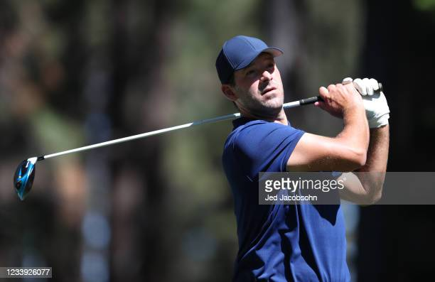 Former NFL athlete Tony Romo tees off from the fourth hole during the final round of the American Century Championship at Edgewood Tahoe South golf...