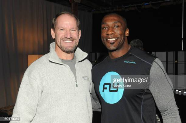 Former NFL Coach Bill Cowher and former NFL player Shannon Sharpe attend The Flywheel Challenge at the NFL House hosted by Shannon Sharpe at The...