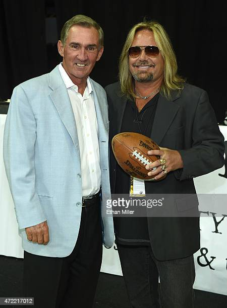 Former NFL coach Mike Shanahan and Motley Crue singer and Las Vegas Outlaws owner Vince Neil pose before the Outlaws' game against the Los Angeles...