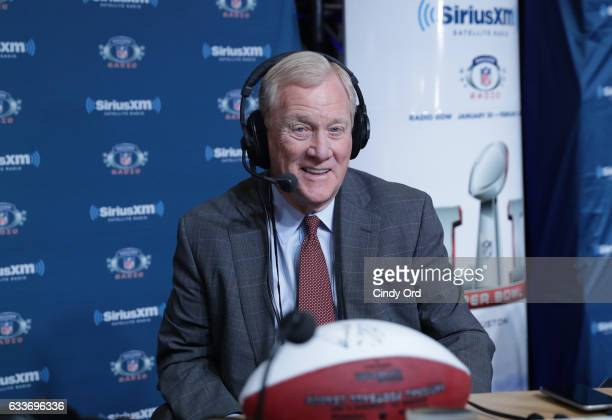 Former NFL executive and current ESPN sports analyst Bill Polian visits the SiriusXM set at Super Bowl LI Radio Row at the George R Brown Convention...