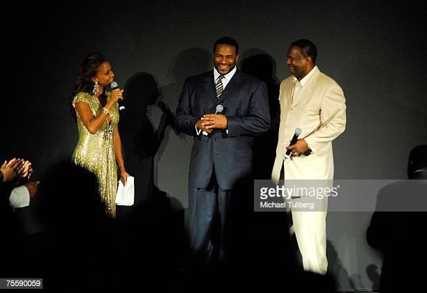 Former NFL football star Jerome Bettis is honored by former NFL quarterback Rodney Peete onstage at the Designcare 2007 celebrity benefit held by...