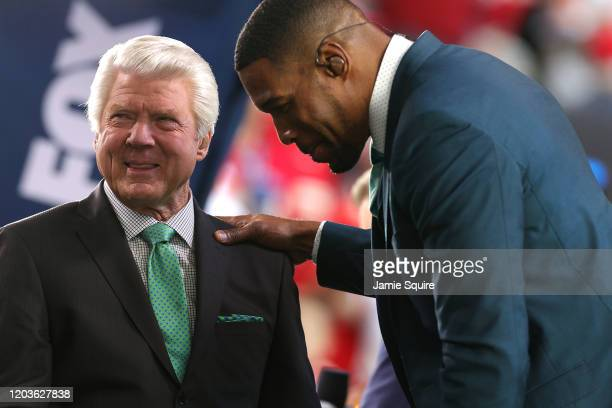 Former NFL head coach and Fox Sports analyst Jimmy Johnson talks with former NFL player and Fox Sports analyst Michael Strahan prior to Super Bowl...