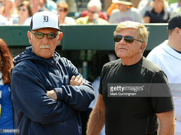 Former NFL head coach Jerry Glanville talks with Detroit Tigers manager Jim Leyland prior to the spring training game against the Atlanta Braves at...
