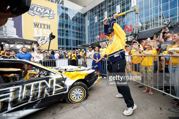 Former NFL head coach Rex Ryan prepares to hammer the Penguins car prior to Game Three of the 2017 NHL Stanley Cup Final at Bridgestone Arena on June...