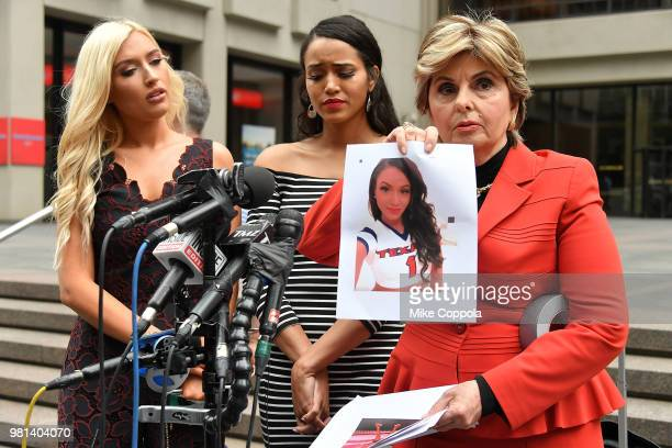 Former NFL Houston Texans cheerleaders Hannah Turnbow and Angelina Rosa watch Attorney Gloria Allred holds up a photo as she hosts a press conference...