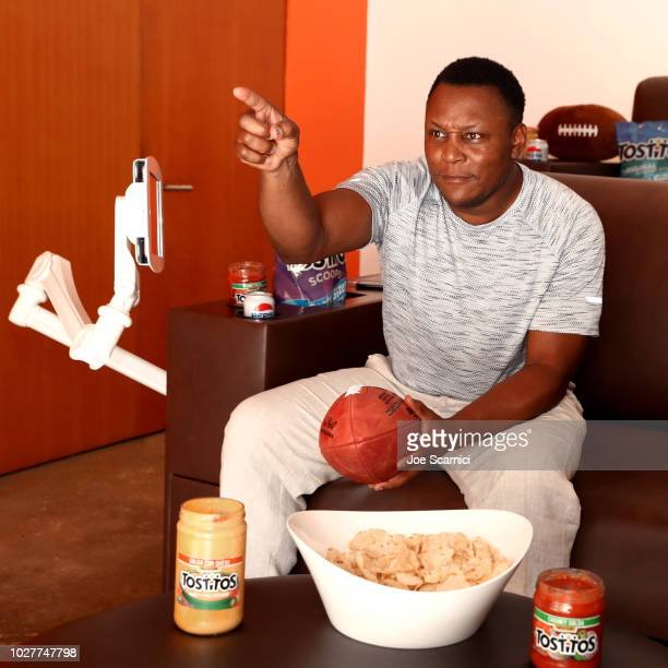 Former NFL Legend Barry Sanders gets a prime seat on the sofa within arms length of the Tostitos chips and dips and Pepsi beverages on August 31 2018...