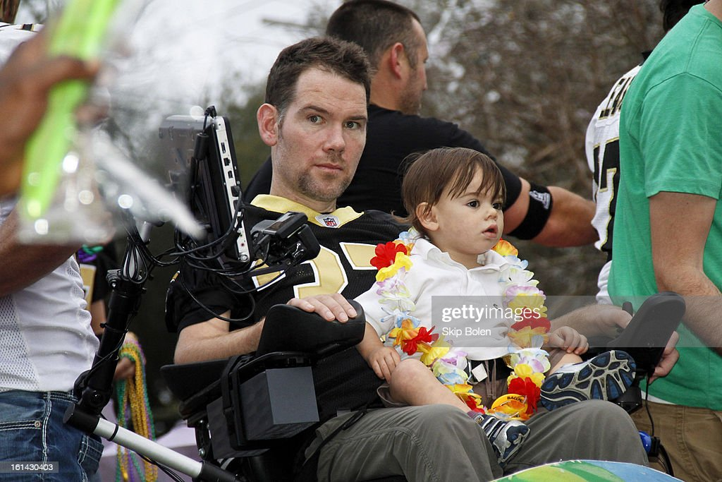 Former NFL New Orleans Saints Safety, Steve Gleason with friends that started Team Gleason to generate public awareness and raise funds for Amyotrophic Lateral Sclerosis rides in the 2013 Krewe of Bacchus Mardi Gras Parade on February 10, 2013 in New Orleans, Louisiana.