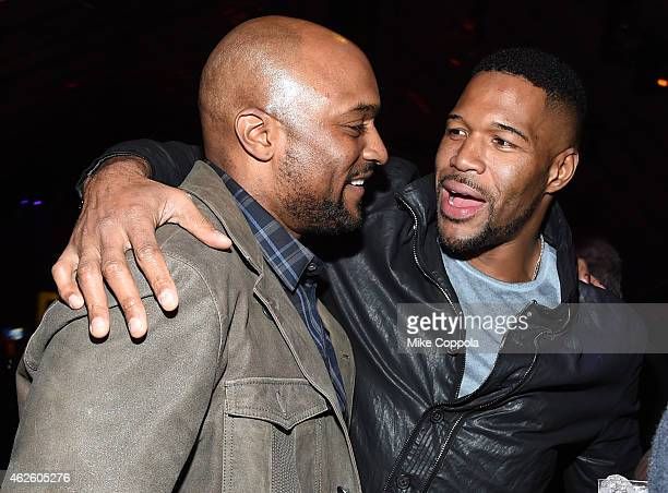 Former NFL player Amani Toomer and host Michael Strahan attend DirecTV Super Saturday Night hosted by Mark Cuban's AXS TV and Pro Football Hall of...