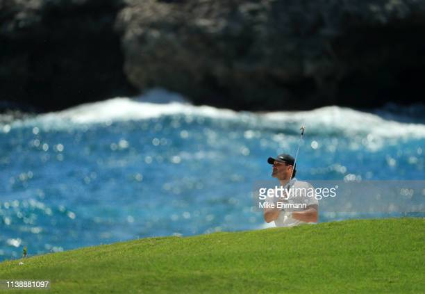 Former NFL Player and amateur Tony Romo plays a shot from a bunker on the 18th hole during the first round of the Corales Puntacana Resort & Club...