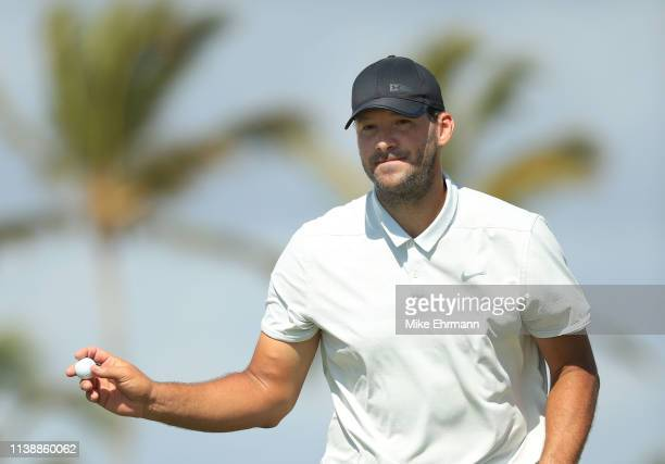 Former NFL Player and amateur Tony Romo reacts to his putt on the seventh green during the first round of the Corales Puntacana Resort Club...