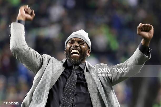 Former NFL player and current ESPN personality Randy Moss reacts during pregame before the game between the Minnesota Vikings and the Seattle...