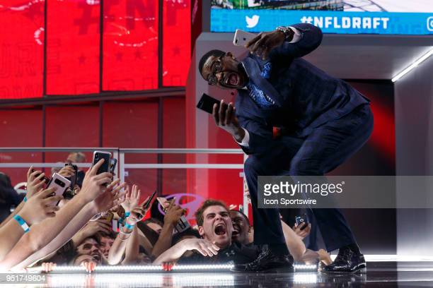 Former NFL player and current NFL Network Host Michael Irvin poses with fans during the first round of the NFL Draft on April 26, 2018 at AT&T...