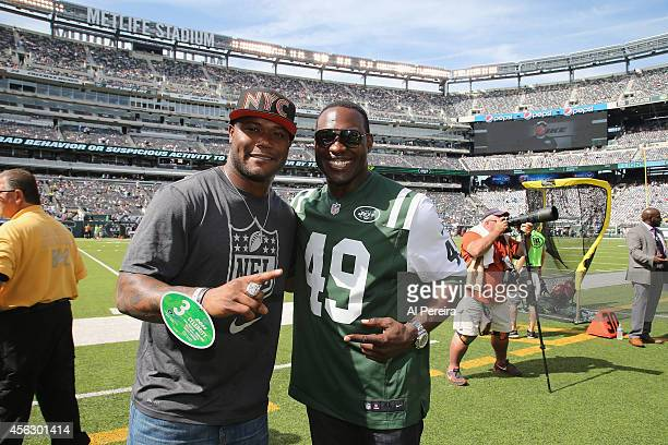 Former NFL player and current NFL Network personality Michael Robinson and former New York Jets fullback Tony Richardson attend the Detroit Lions vs...
