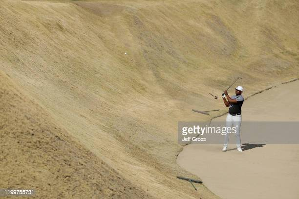 Former NFL player and Hall of Famer Eric Dickerson plays a bunker shot on the 16th hole during the American Express Bob Hope Legacy Pro-Am on the...