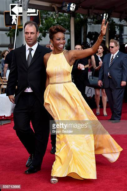 Former NFL player Brian Musso and actress Heather Headley arrive at FIJI Water at 2016 Tony Awards at The Beacon Theatre on June 12 2016 in New York...