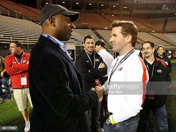 Former NFL player Chris Carter and CEO Kevin Plank of Under Armour talk before the All America Under Armour Football Game at Florida Citrus Bowl on...