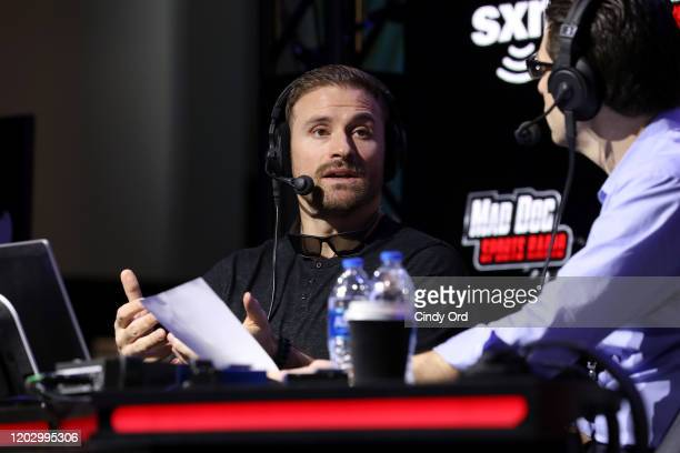 Former NFL player, Chris Long and SiriusXM host Adam Schein speak onstage during day 2 of SiriusXM at Super Bowl LIV on January 30, 2020 in Miami,...