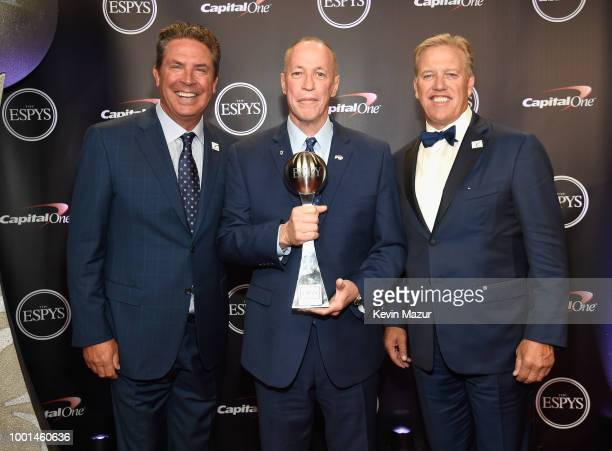 Former NFL player Dan Marino, recipient of the Jimmy V Award for Perseverance Jim Kelly and former NFL player John Elway pose during The 2018 ESPYS...