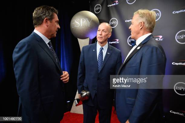 Former NFL player Dan Marino recipient of the Jimmy V Award for Perseverance Jim Kelly and former NFL player John Elway pose during The 2018 ESPYS at...