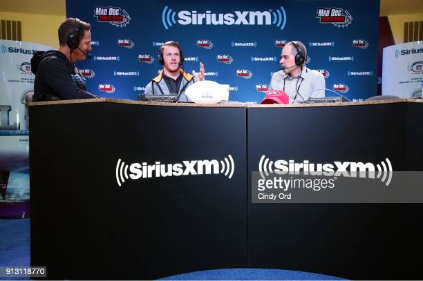 Former NFL player Danny Kanell Kyle Rudolph of the Minnesota Vikings and SiriusXM radio host Steve Torre attend SiriusXM at Super Bowl LII Radio Row...