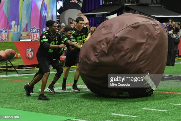 Former NFL player Deion Sanders and NFL players Stefon Diggs and Luke Kuechly attend the Superstar Slime Showdown taping at Nickelodeon at the Super...