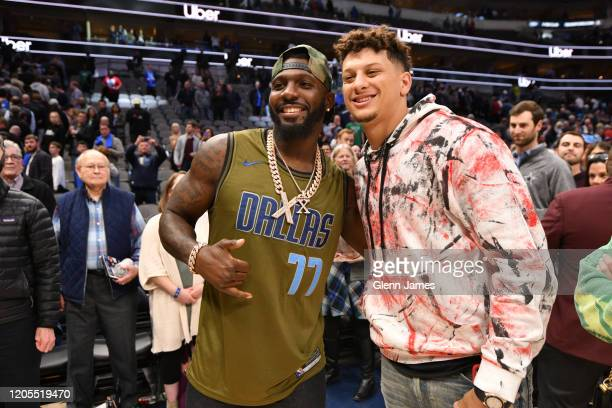 Former NFL player Dez Bryant and Chiefs quarterback Patrick Mahomes attend a game between the New Orleans Pelicans and the Dallas Mavericks on March...