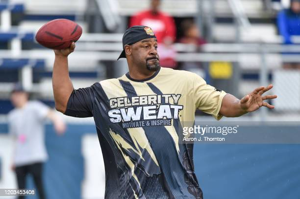 Former NFL Player Donovan McNabb looks to throw a pass during the 20th Annual Super Bowl Celebrity Sweat Flag Football Challenge at Riccardo Silva...