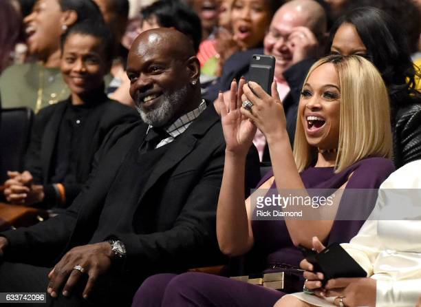 Former NFL player Emmitt Smith and president of Pat Emmitt Smith Charities Pat Smith react during the BET Presents Super Bowl Gospel Celebration at...