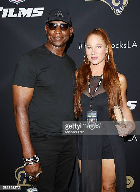 Former NFL player Eric Dickerson and Penny Sutton arrive at the Los Angeles premiere of HBO and NFL Films Hard Knocks Training Camp with the Los...