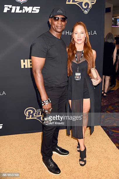 Former NFL player Eric Dickerson and Penny Sutton attend the LA premiere of HBO's Hard Knocks Training Camp With The Los Angeles Rams at Regal LA...