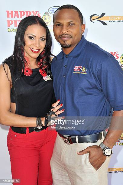 Former NFL player Eric King and recording artist SoulFia King host grand opening of Happy's Pizza on July 12 2015 in Los Angeles California