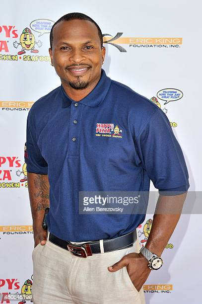 Former NFL player Eric King hosts the grand opening of Happy's Pizza on July 12 2015 in Los Angeles California