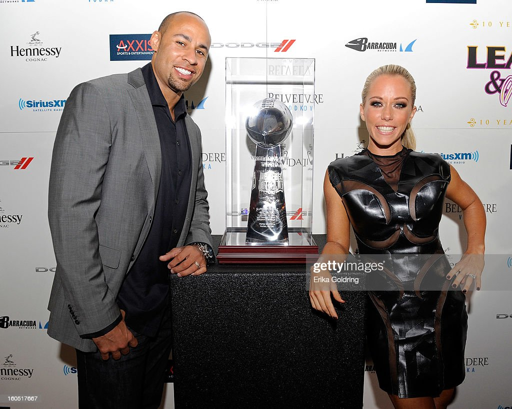 Former NFL player Hank Baskett and wife Kendra Wilkinson pose with the Lombardi Trophy at the Tenth Annual Leather & Laces Super Bowl Party on February 1, 2013 in New Orleans, Louisiana.