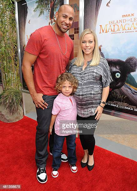 Former NFL player Hank Baskett TV personality Kendra Wilkinson and their son arrive at the Premiere of Warner Bros Pictures and IMAX Entertainment's...