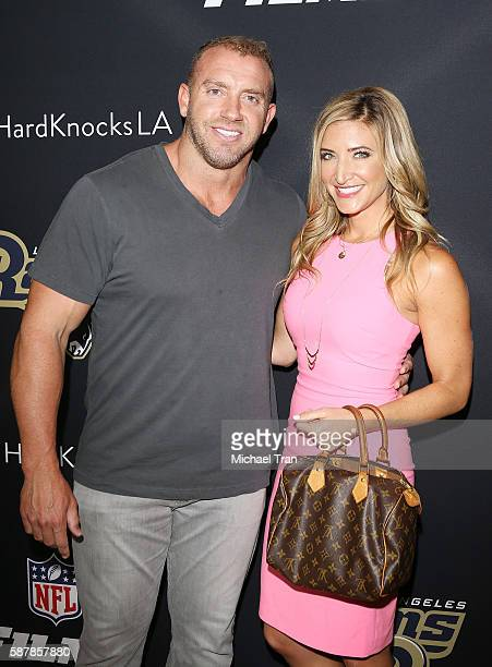 Former NFL player Heath Evans and Cynthia Frelund arrive at the Los Angeles premiere of HBO and NFL Films Hard Knocks Training Camp with the Los...