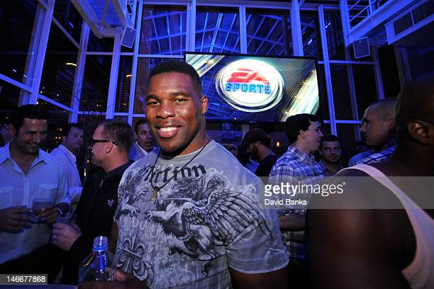 Former NFL player Herschel Walker at the EA SPORTS Madden NFL 13 Pigskin ProAm Eve on June 21 2012 in Chicago Illinois