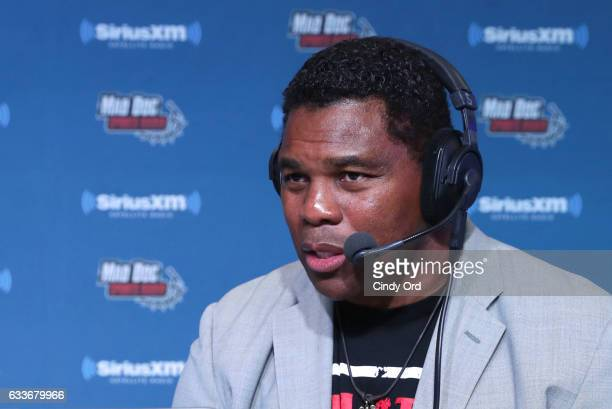 Former NFL player Herschel Walker visits the SiriusXM set at Super Bowl LI Radio Row at the George R Brown Convention Center on February 3 2017 in...