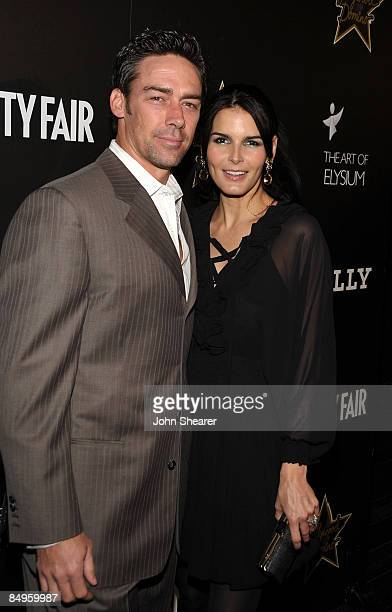 Former NFL player Jason Sehorn and actress Angie Harmon in Bally arrive at the Bally and Vanity Fair Hollywood Domino Game Night benefiting The Art...
