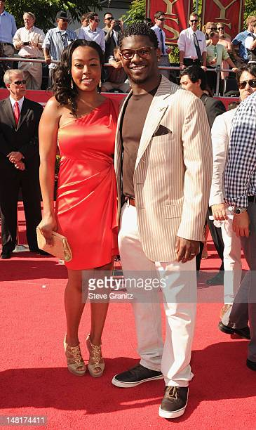 Former NFL player LaDanian Tomlinson and guest arrive at the 2012 ESPY Awards at Nokia Theatre LA Live on July 11 2012 in Los Angeles California